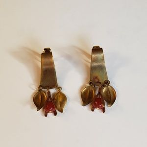 Gold tone dangle clip on earrings